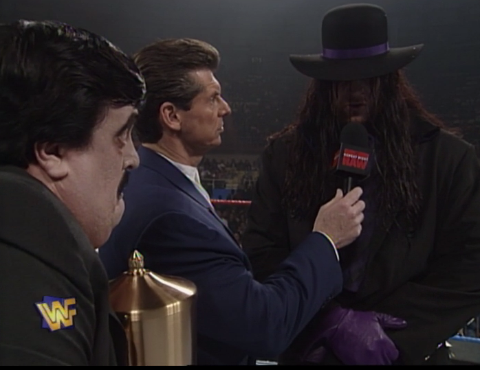Undertaker lookin' like a pimp in mourning.