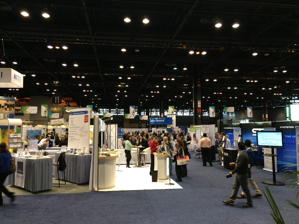 The view from the conference's main hall with busy exhibits at APHA 2015.