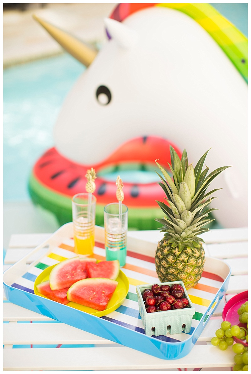 Colorful poolside party by Meredith Staggers the gal behind Cake & Confetti a Houston-based lifestyle and party blog.