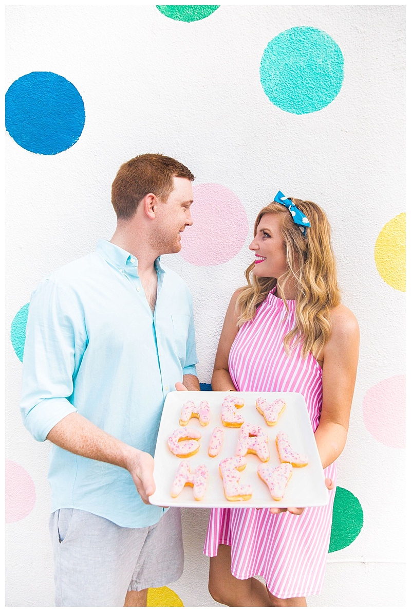 Meredith Staggers of Cake & Confetti is expecting a baby girl! She shares the news with a donut filled baby announcement!