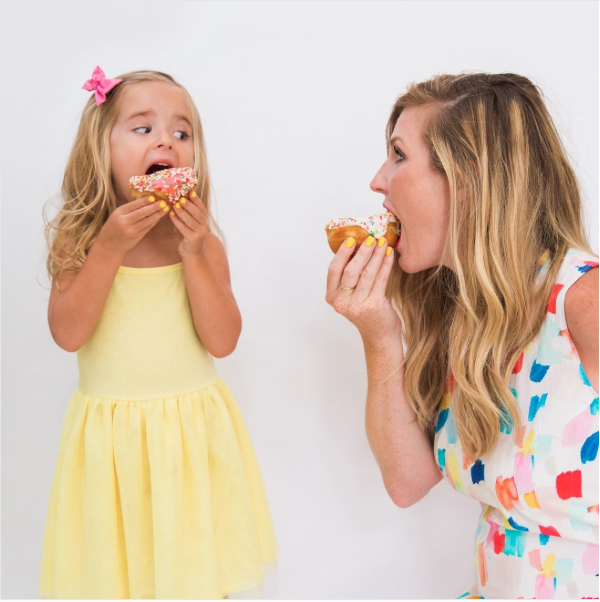 girls eating bright donuts Cake and Confetti.png