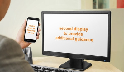 We explored the concept of using a second display to help a user learn to use a mobile device.
