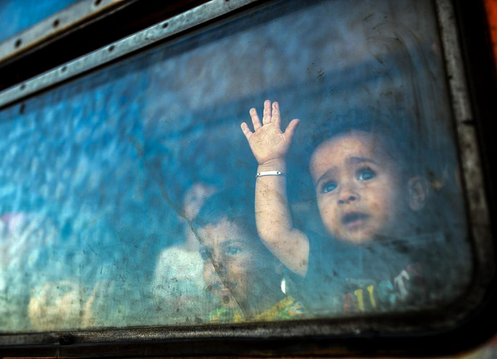 A migrant boy looks through a window onboard a train for Serbia. Source: Robert Atanasoviski/AFP/Getty Images)