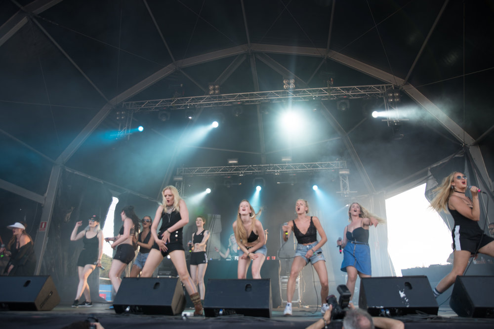 "The 16 piece feminist ""rap clan"" Reykjavíkurdætur performing at Benicàssim Festival in Spain last year. Credit: Iñaki Espejo-Saavedra (Flickr)."