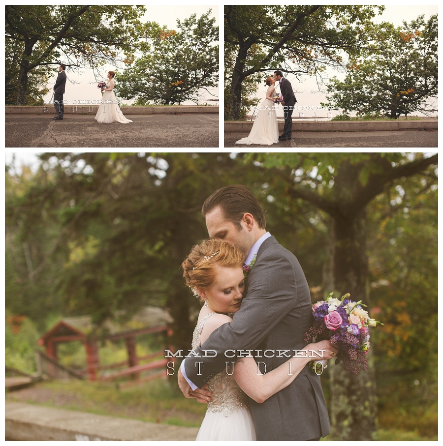 11 duluth wedding photographer mad chicken studio photographing bride and groom seeing each other at lutsen resort.jpg