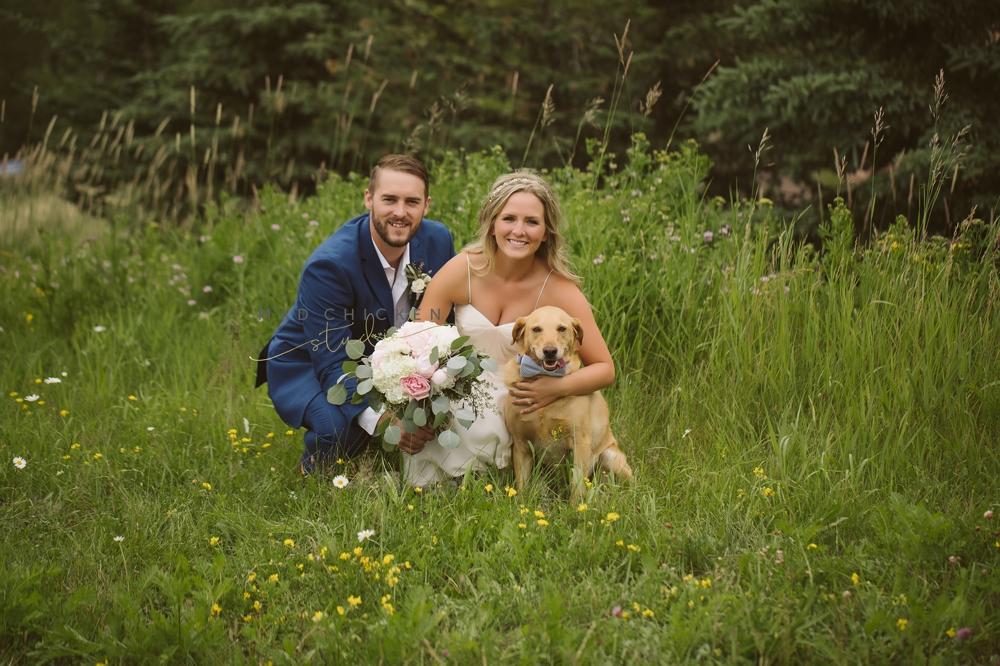 bride, groom, and dog in Lutsen, MN