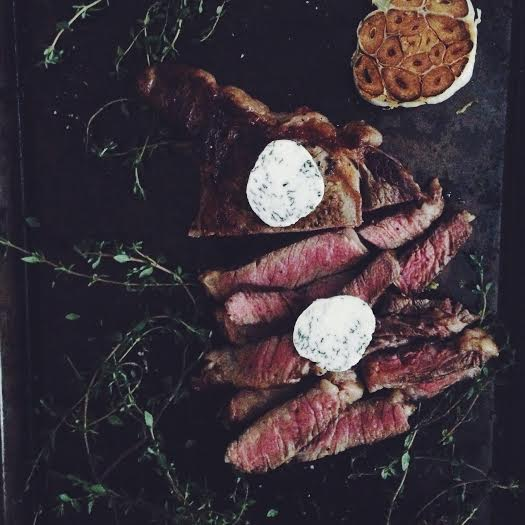 seared ribeye with roasted garlic and thyme butter