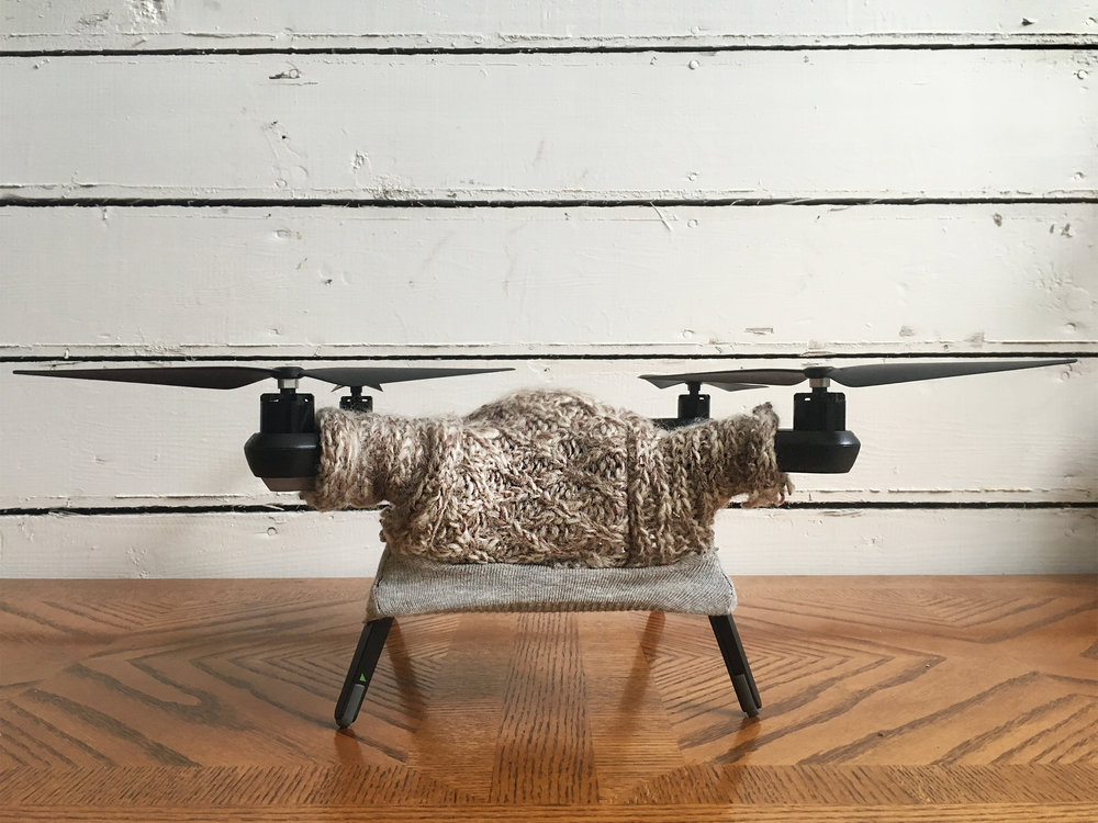 A drone with a sweater (via Drone Sweaters)