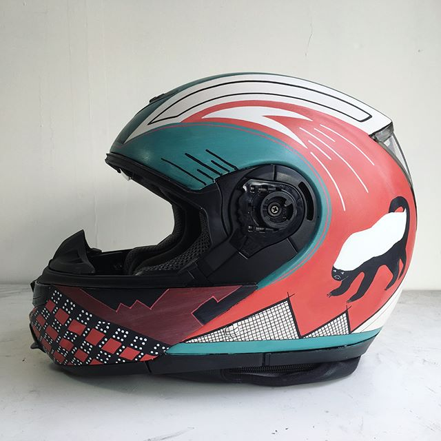 Customized this helmet with layered geometrics and a #honeybadger on each side. Good surface area to work with! We'll paint your #motorcycle helmet if you send it to us.