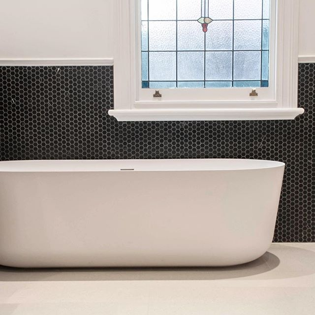 The bath view to the bathroom at the Shenton park home renovation. One of my favourite baths by @falperdesign extremely slim, timeless and elegant a great fit for the timeless modern bathroom style.⠀ .⠀ Interior design & cabinetry detail by me @turner_interior_design⠀ .⠀ Cabinets built by Caruso cabinets⠀ .⠀ Build by @assemble_wa⠀ .⠀ Photo by me⠀ #classicmodern #freestandingbaths #bathroomrenovation #homerenovation #bathroomrenovation #interiordesign #interiorarchitecture #ethicaldesign