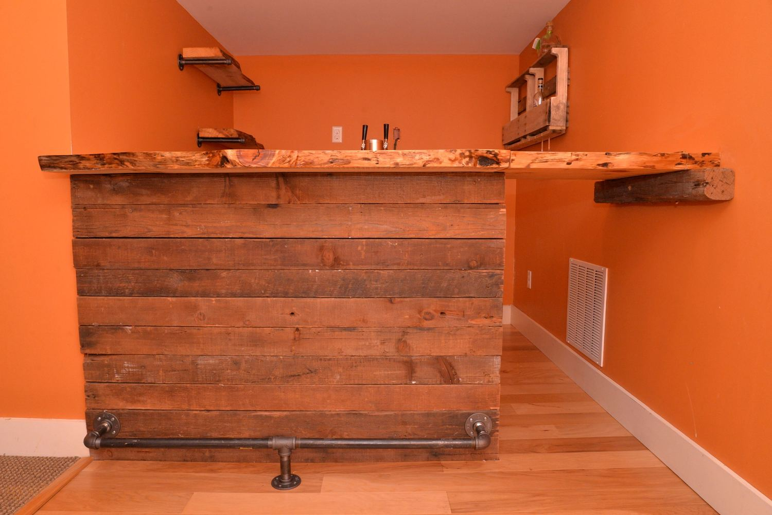 Reclaimed Wood Transformed Into A Working Basement Bar