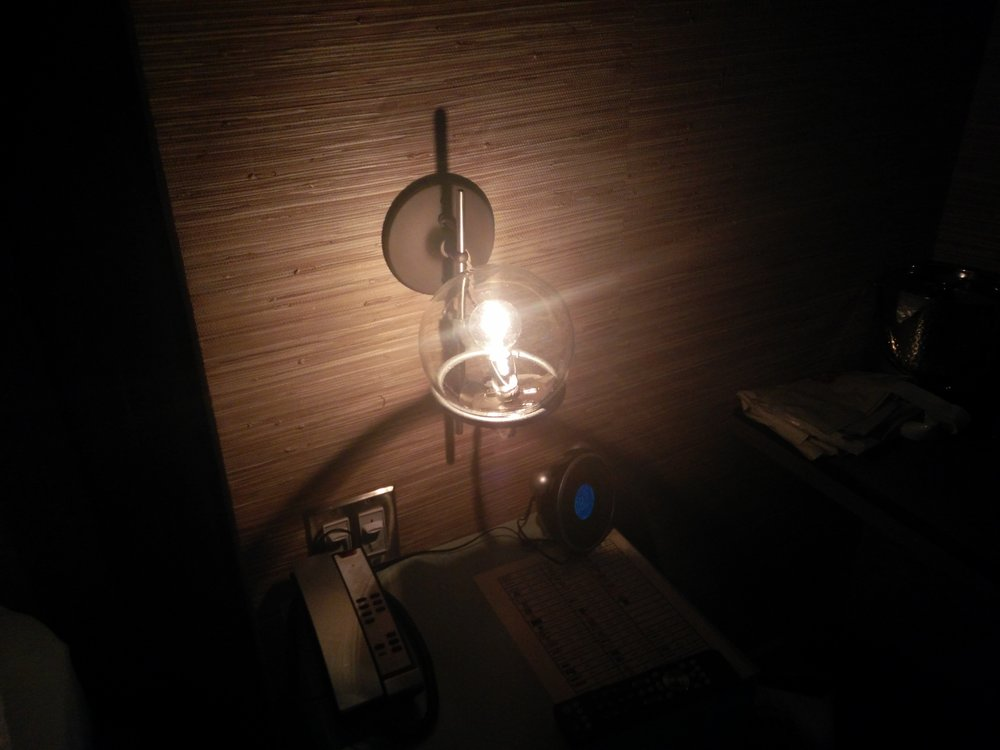 My hotel room on a recent work trip to the States had a  very   Tome -cover-like light bulb / lamp in it which constantly reminded me of  Resolver  work while away.