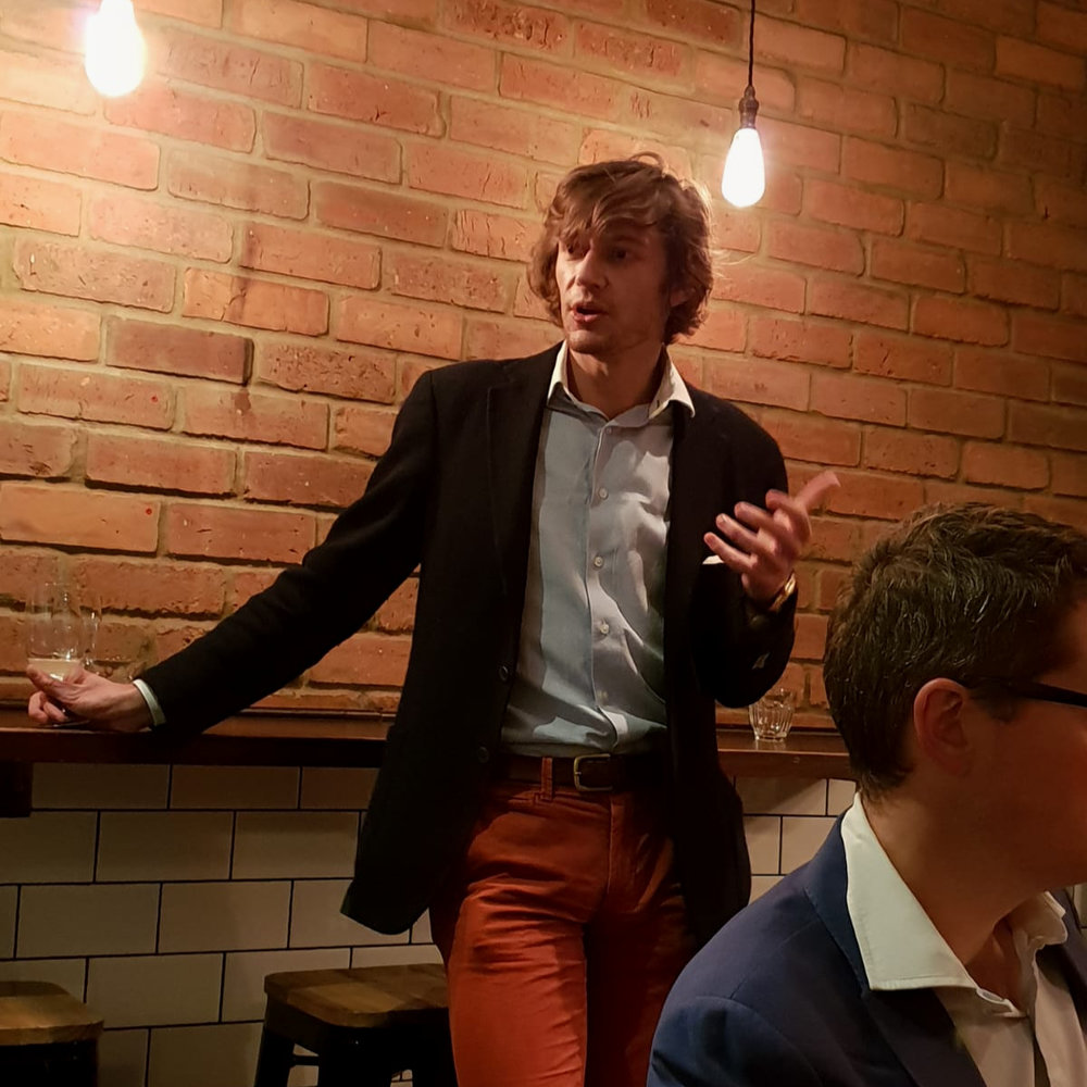 James Flewellen presenting a wine tasting at Linden Stores, London.