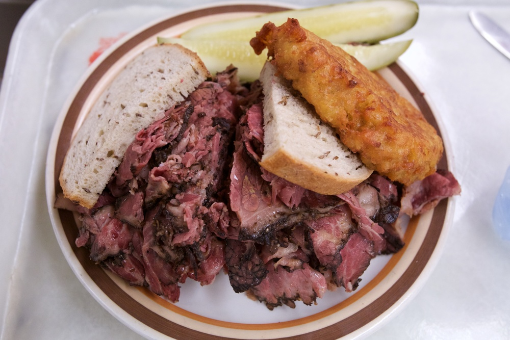 Pastrami sandwich with a potato latke - Manny's Cafeteria &  delicatessen