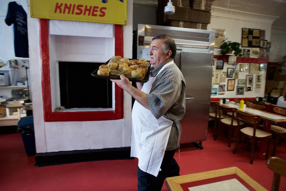 ALEX WOLFMAN CARRYING A TRAY OF FRESH KNISHES