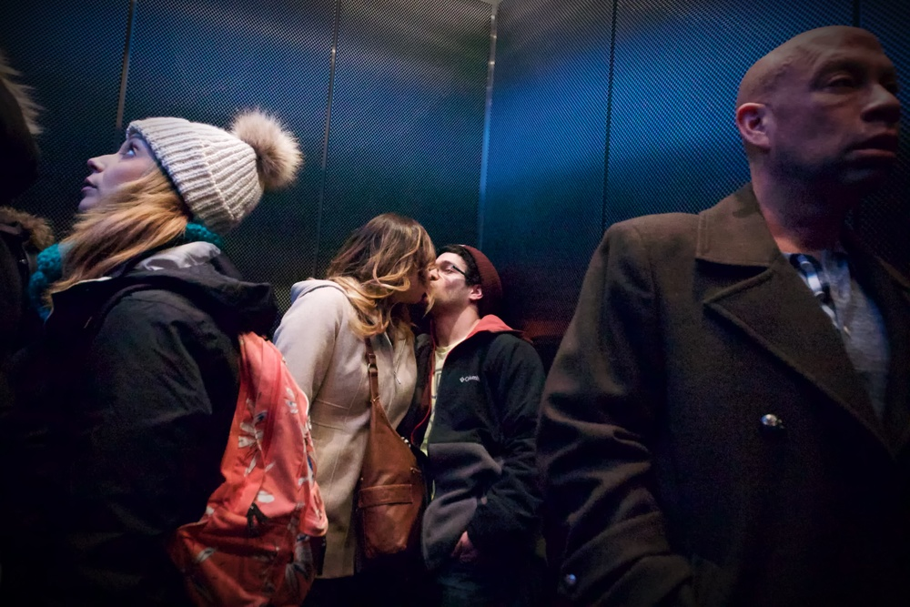 "This ""Kiss"" was on the elevator up to the Skydeck at Willis Tower.   The other passengers appear unaware of ""the 103 Story Kiss>"""