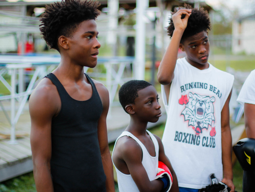 "Dennis (black shirt) and Deshane (white shirt) Sims, 15 year old twins, know the hardships and difficulties of growing up in the Lower Ninth Ward. Their grandfather, Harry, helps their mother keep them on track. ""This generation here [our goal] is to bring them up, teach them how to do things, make them straight in the mind,"" said Harry."