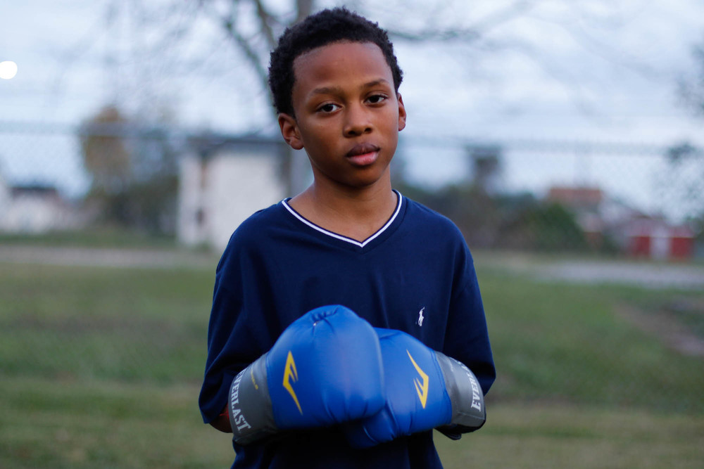 Amarion Ozan, 12, joined the other boys that day after taking a long break from boxing. The next day, Saturday, he will be picked up by Coach Ford to run around the track at the community center. Coach Ford wants him to continue training to compete in a tournament in 2016.