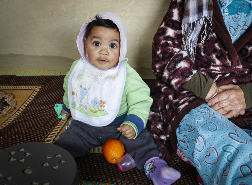 Ismail, Abdullah Amil's son, sits with his grandmother Walida in the open corridors of their Beni Koulla home. In traditional Moroccan families, generations live together and grandmothers often take care of their grandchildren.