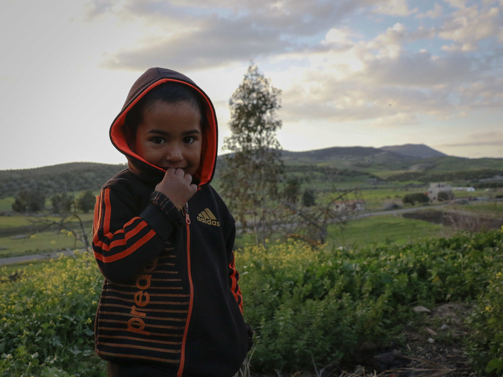 Othmane, 5, is the youngest child of Hana. Most days, he walks about 25 minutes with other village children to go to the primary school down the road. Today is Sunday, so he can stay around his mother and play with his neighbors.