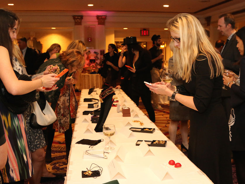 2015-Gala-Silent-Auction-Center-Table-with-people-bidding.jpg