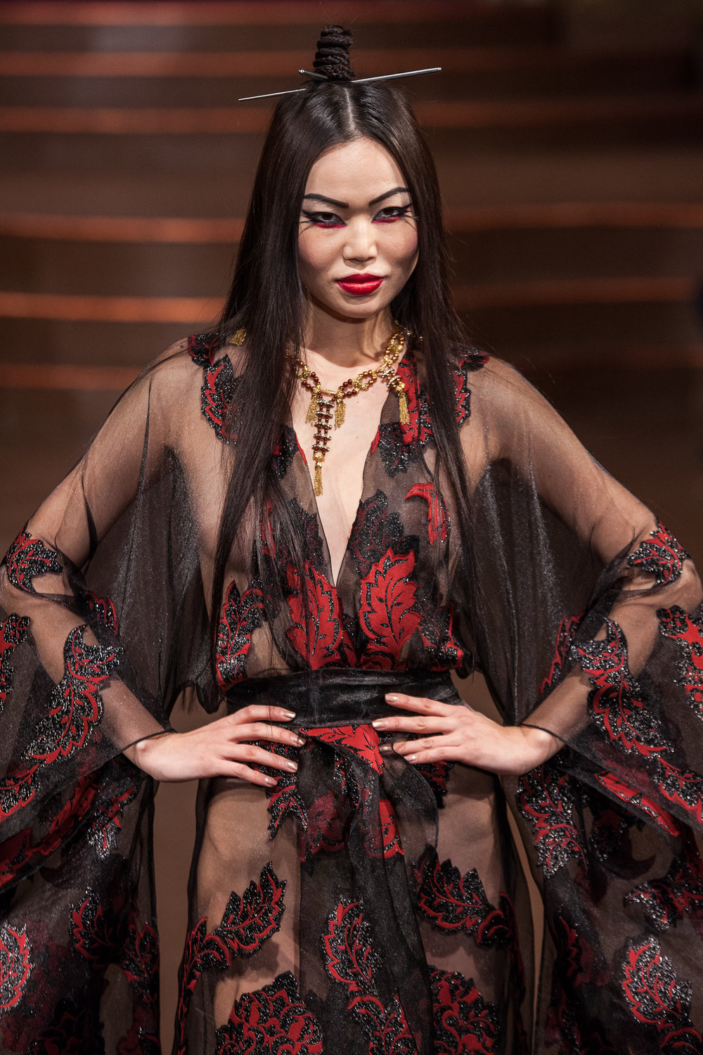 Stello exemplified how culture impacts the fashion industry - Models done up with edgy chopsticks in their hair and elaborate eye makeup strutted down the runway in designs that were definitely Asian-inspired.@stello