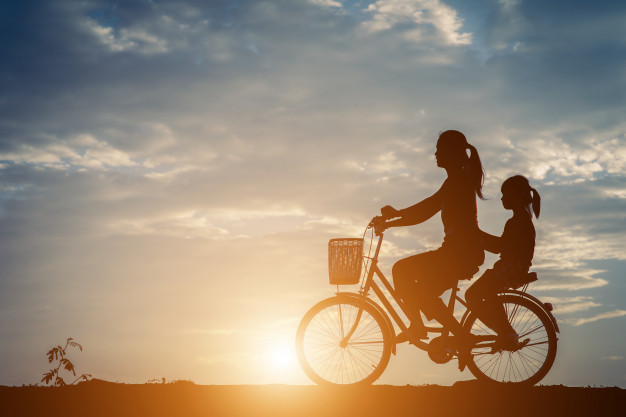 silhouette-mother-with-her-daughter-bicycle_1150-5339.jpg