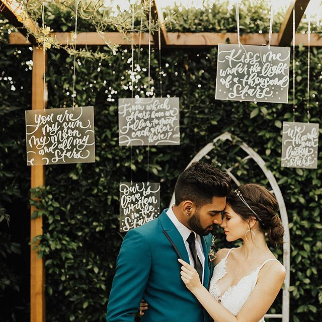 Featured over on @greenweddingshoes today in a moody + modern celestial styled shoot! ✨ For this Across the Universe theme, I created several acrylic sheets with celestial love sayings that the gals over at @eventivemoments hung so elegantly at the ceremony site. All the incredible details were so dramatically captured by @withlovebygeorgie.  Check it all out, including my embossed copper and acrylic invitation suite, featured over on GWS—link in profile!  Talented vendor team: Photographer @withlovebygeorgie Venue @therubystreet Event design & planning @eventivemoments Floral design @eventivemoments Invitation/Calligraphy @masonalleycalligraphy HMUA @benyla Cake @taste_likeheaven Bride @taylorpirollo Groom @danyal.naeem_ Dress @zinare_bridal Groom suit @friartux & @asos Rentals @mtb_event_rentals . . . #wedding #weddingstyle #greenweddingshoes #GWS #weddingstyleshoot #styledshoot #brideandgroom #weddingphotography #rubystreet #weddingcoordinator #losangeleswedding #lawedding #weddinginspiration #losangelescalligrapher #destinationbride #weddinginspo #huffpostido #weddingidea #weddingwire #curiouscalligrapher #calligrapher #celestial #starsalign #weddingvendor