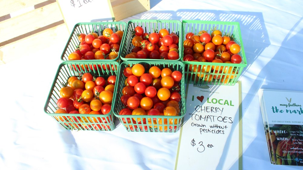 Cherry Tomatoes grown right in the  Many Feathers Garden ! We harvest a day or two before our markets, so you know you're getting the freshest produce at our markets.