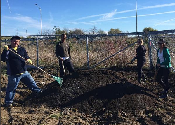 Alex, Alexander, Sam, and Nicole spreading soil at Sids' Pond in November 2016