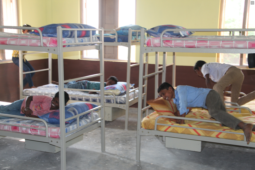 This is the first time these orphans have had a bed of their own