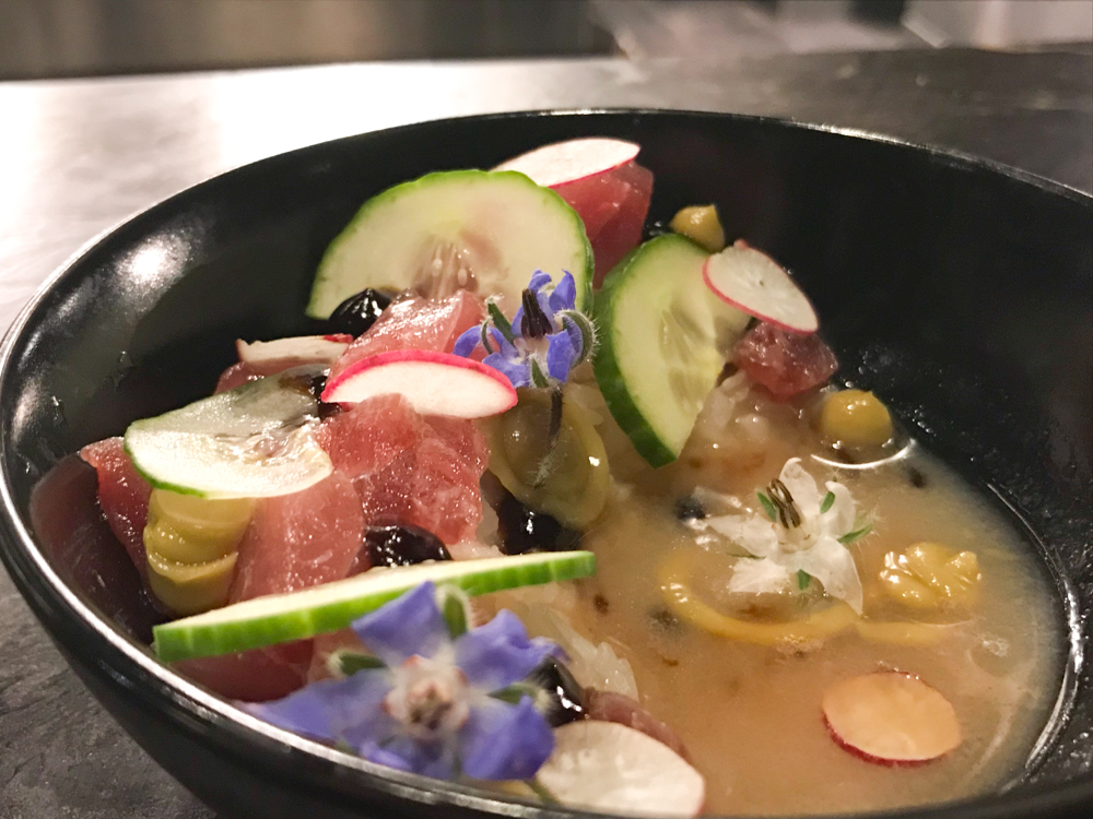 Ahi tuna poke with nuoc cham and beautiful borage blossoms.