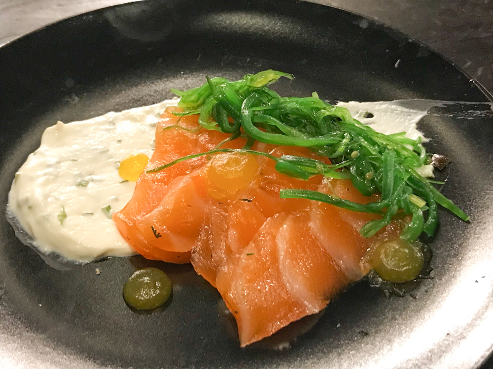 House-cured gravlax with   chèvre  , wakame and lemon pudding.