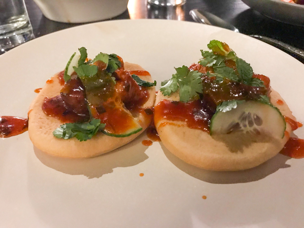 Steamed buns with crispy pork belly and a homemade hoisin with cucumber, cilantro and mint.