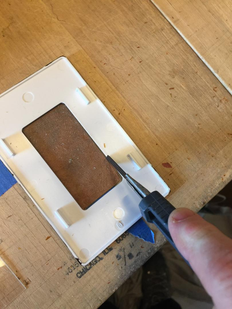 Trimming the switch plate.
