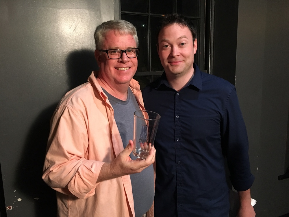 Peter Cunniffe poses with emcee Mikey Gleason and the prized pint glass!