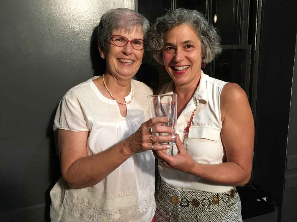 Diane Yannick and Jane Butler pose with the prized pint glass!