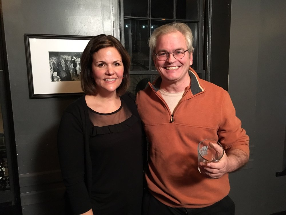 Emcee Luanne Sims poses with February winner Patrick Carmody