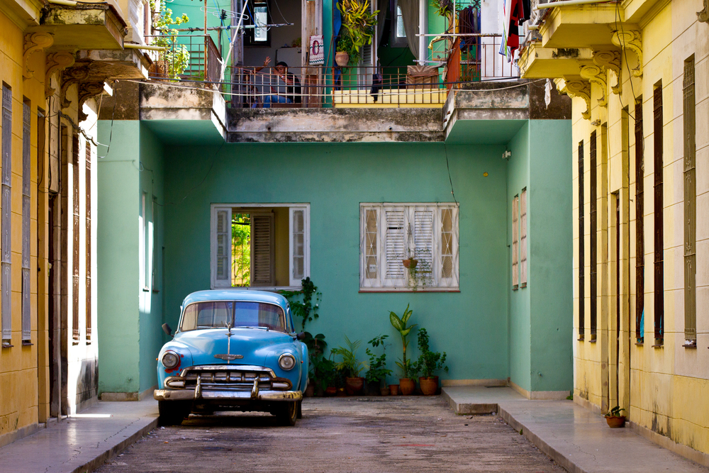 Beautiful vintage car in beautiful ally in Havana Cuba