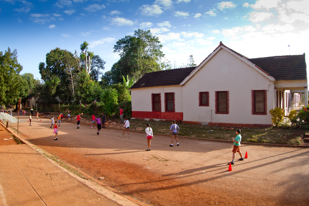 Children playing soccer in the street, Brasil, Cuba