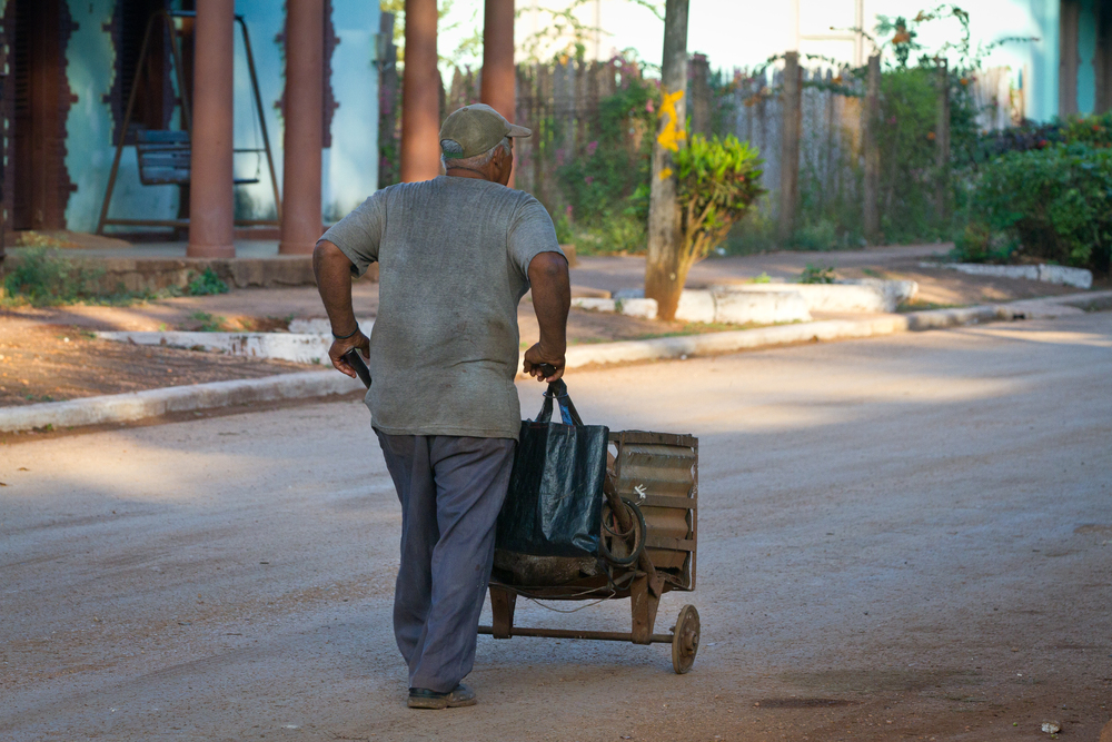Local man with his made from scratch wheelbarrow, Cuba