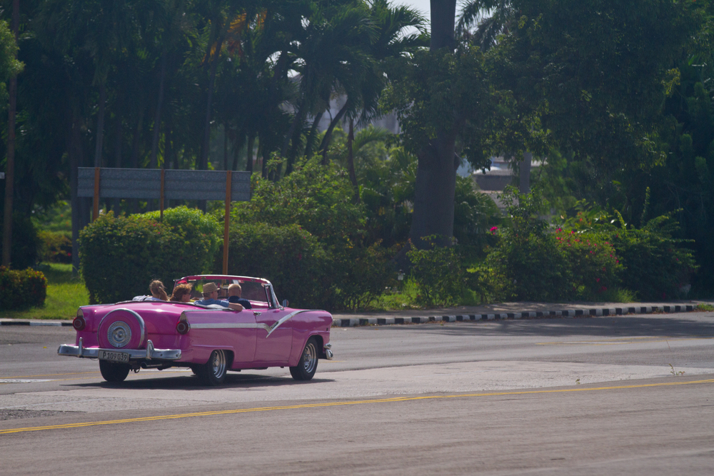 Classic American car with tourists on board, Havana, Cuba
