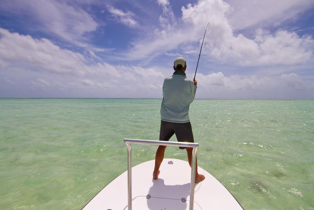 Fighting a Permit from the flats skiff, Cayo Cruz, Cuba