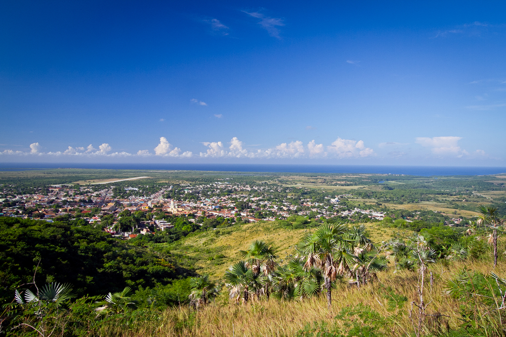 The city of Trinidad, nestled in the hills with the southern coast of Cuba only a few miles in the distance.