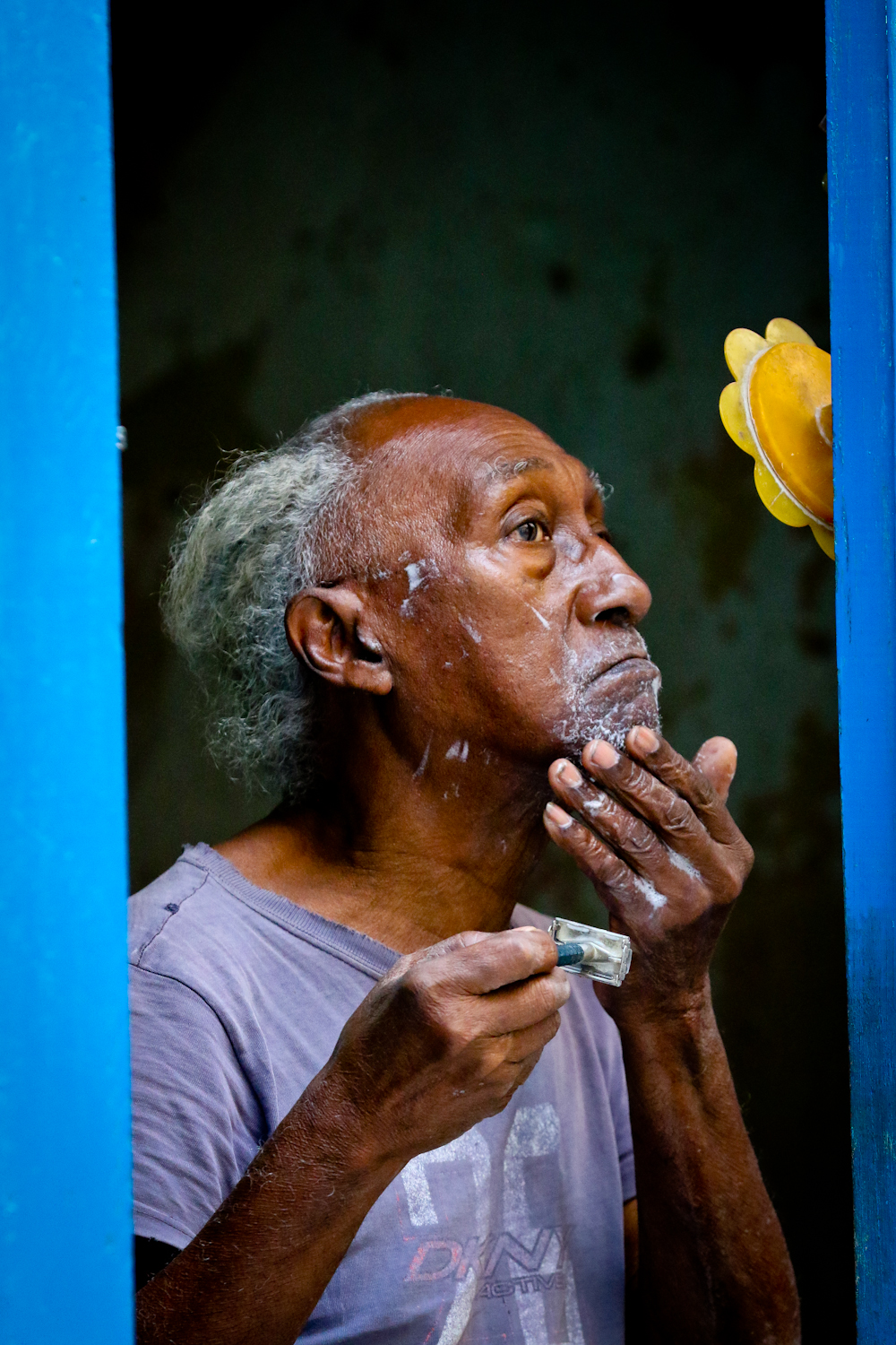 Life in Cuba is visible. People have their doors and windows open much of the time (few have A/C) and so you can see a lot of everyday happenings. This beautiful old guy in Havana was doing his best to get a close shave, on the little mirror next to his front door.