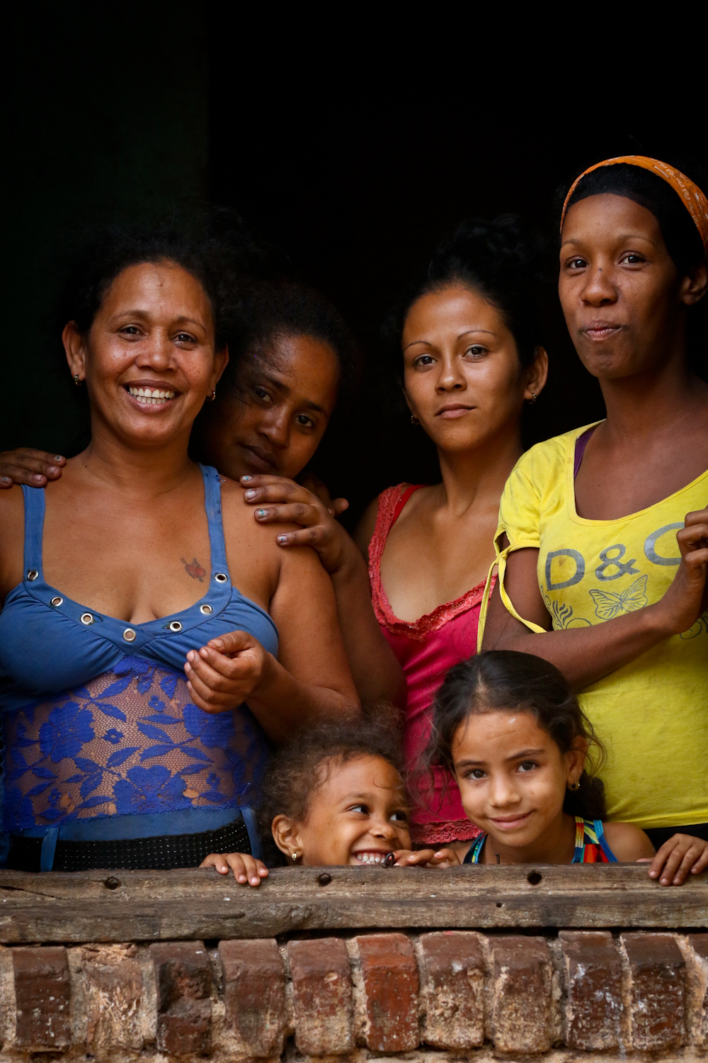 This might be my favorite people shot of the trip. In the small town of Brasil in the rural countryside, life is pretty tough. I was stopped on the street by some guys wanting me to take their photo, and when I was done I saw all these gals watching from the window of their shabby building. Look at their faces! In can see Joy in one, Shyness in the next, Confidence on another, and Uncertainty in the last.