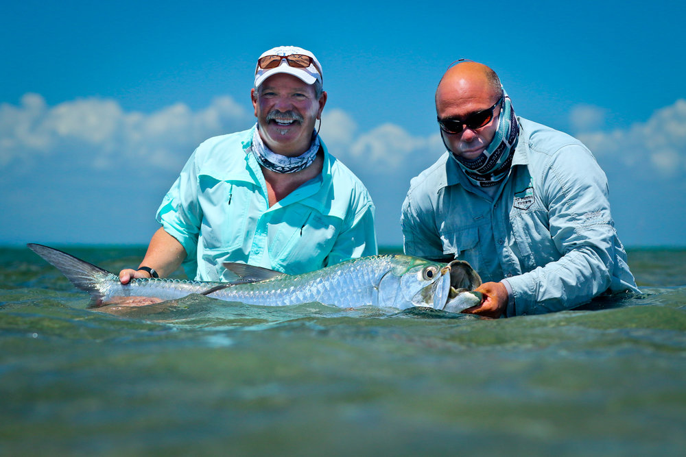 Tim and Elyses with an average Tarpon.