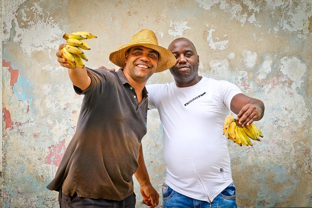 These great guys worked in a corner bodega, where I was trying to sneak some shots of customers buying their fruit and veggies. They busted me.....and wanted a photo of themselves!