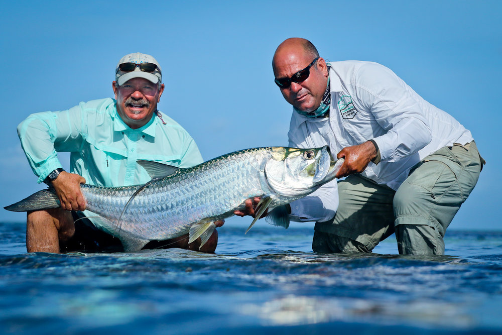 Tim Cudney and our guide Elyses with a perfect Tarpon from GOK