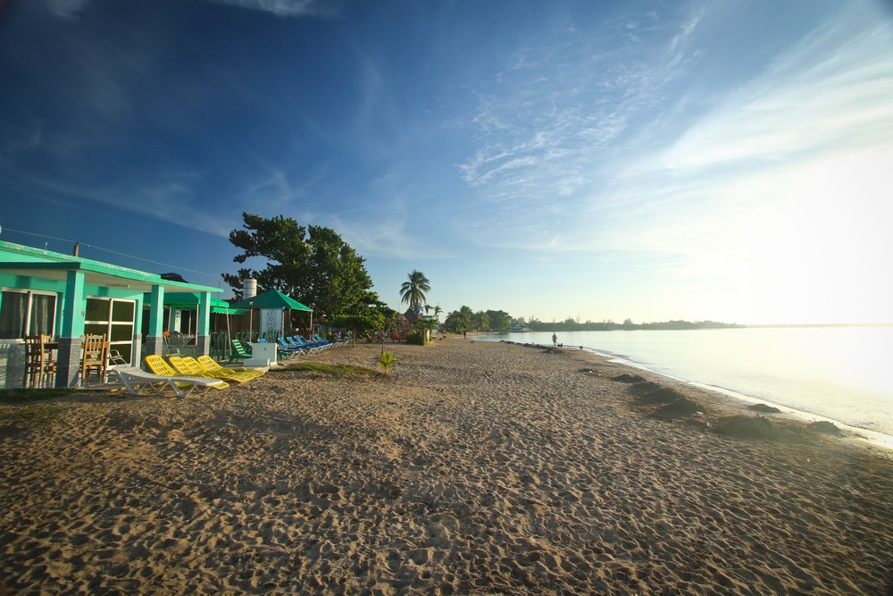 The beach and private guest-houses along the Bay of Pigs in the small town of Playa Larga